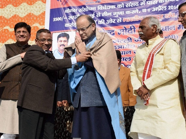 Finance Minister Arun Jaitley is felicitated at a function organised by Bharatiya Mazdoor Sangh (BMS) in New Delhi on Wednesday. Power Minister Piyush Goyal and Labour & Employment Minister Bandaru Dattatreya are also seen