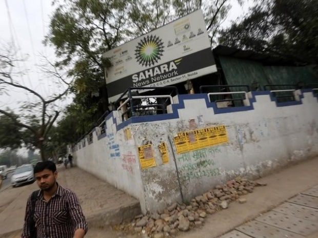 A man walks past Sahara India Complex building in ...