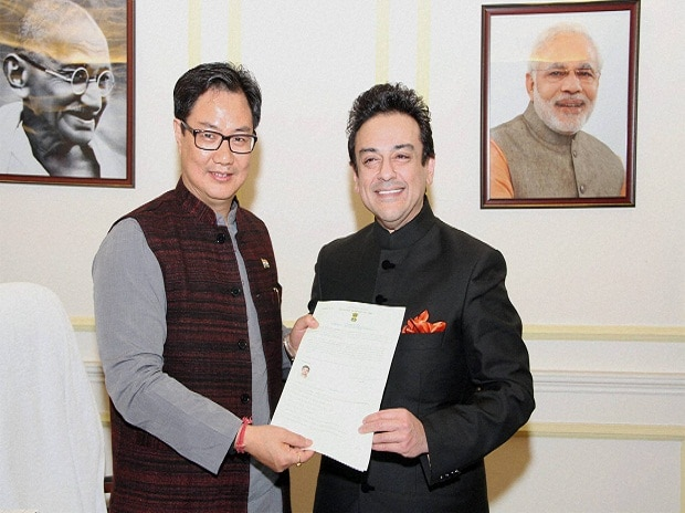 Minister of State for Home Affairs, Kiren Rijiju presenting the Certificate of Indian Citizenship by Naturalization to noted singer and musician Adnan Sami, in New Delhi.
