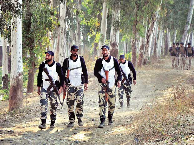 SWAT team conducts a combing operation after an encounter between the security forces and terrorists at the Indian Air Force base in Pathankot on Saturday. Photo: PTI