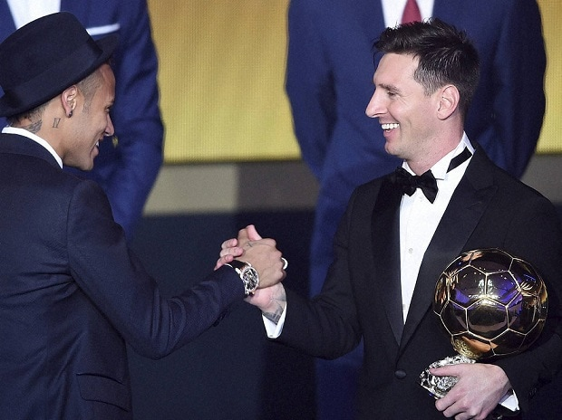 Argentina's Lionel Messi, right, is congratulated by Brazil's Neymar, left, after winning the FIFA Men's soccer player of the year 2015 prize during the FIFA Ballon d'Or awarding ceremony at the Kongresshaus in Zurich, Switzerland, Monday, January 11