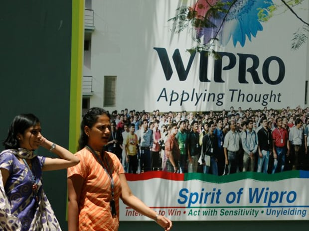 People walk in the Wipro campus in Bengaluru: ...