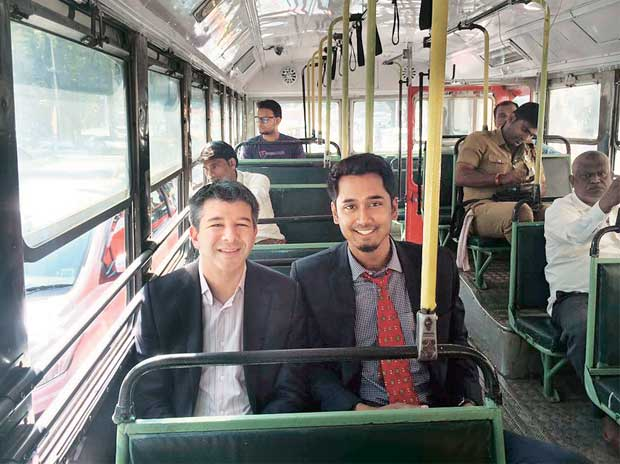 Uber CEO Travis Kalanick (left) on his way to IIT-Bombay in a BEST  bus on Tuesday