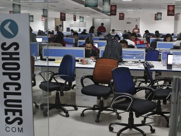 Employees of Shopclues.com, an online marketplace, work inside their office in Gurgaon, on the outskirts of New Delhi. Photo: Reuters