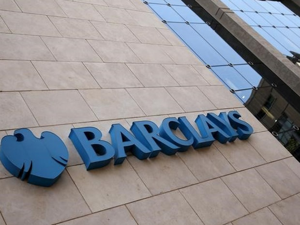 A Barclays logo is pictured outside the Barclays ...