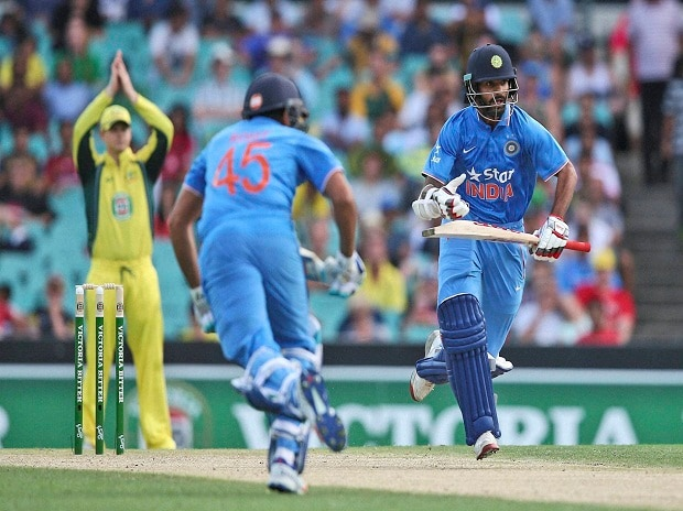 Indian batsmen Shikhar Dhawan and Rohit Sharma run between the wicket during their one-day international cricket match against Australia in Sydney. (File Photo)