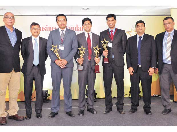 From left: Ajit Balakrishnan, Rajat Gupta, Pranav Bora (third prize winner), Balaji Venkatesh (first prize winner), Sourav Kumar (second prize winner), Sandeep Chandola, and Shashi Ranjan Kumar, at the Business Standard Best B-School Project Award