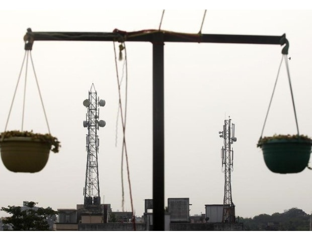 Telecommunication towers are pictured through ...