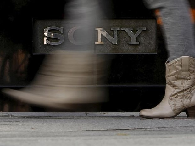 A woman walks past a logo of Sony Corp outside its showroom in Tokyo. Photo: Reuters