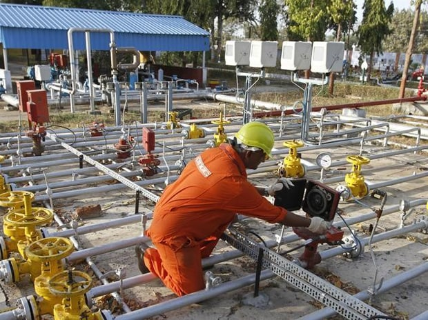 A technician works inside the ONGC group gathering station on the outskirts of Ahmedabad. Photo: Reuters
