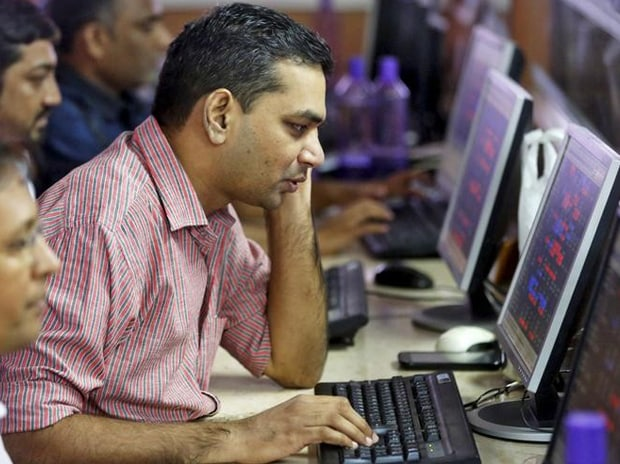 Brokers trade at their computer terminals at a stock brokerage firm in Mumbai. Photo: Reuters
