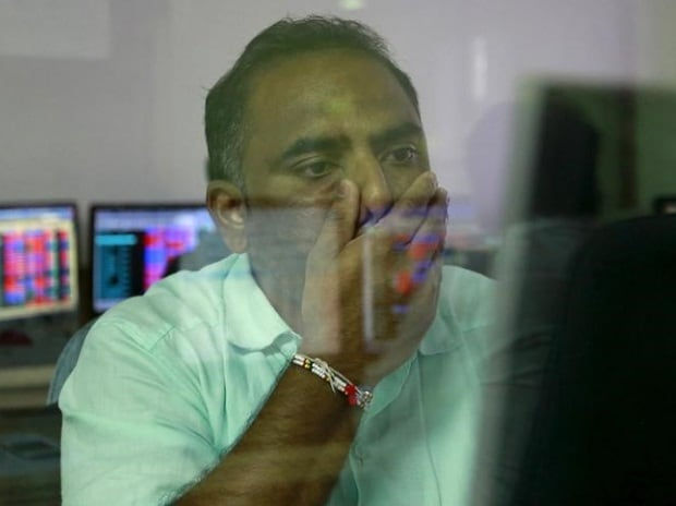A broker reacts while trading at his computer terminal at a stock brokerage firm in Mumbai (pic: Reuters)