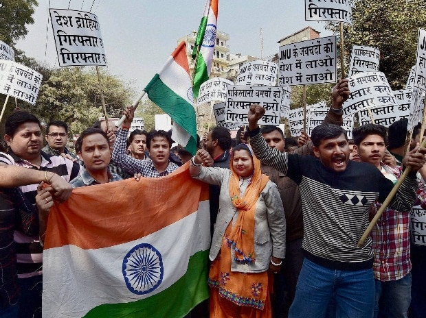 Residents of Munirka village  protest outside the Jawaharlal Nehru University (JNU) against  the organising of a meet to
