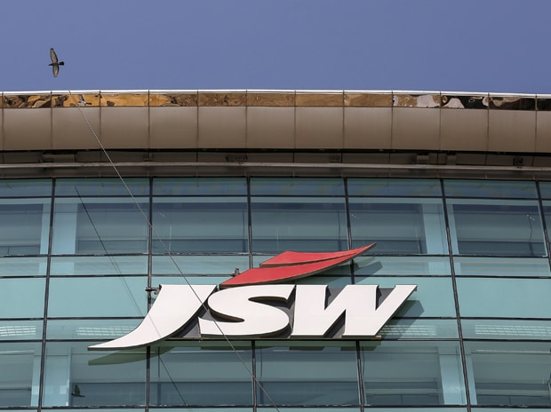 The logo of JSW is seen on the company's ...