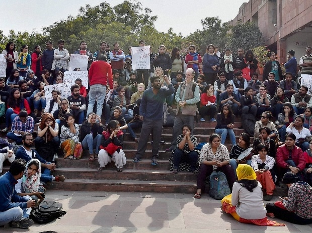 JNU students protest inside the university campus against the arrest of JNUSU President Kanhaiya Kumar, in New Delhi on Monday. PTI Photo by Kamal Singh
