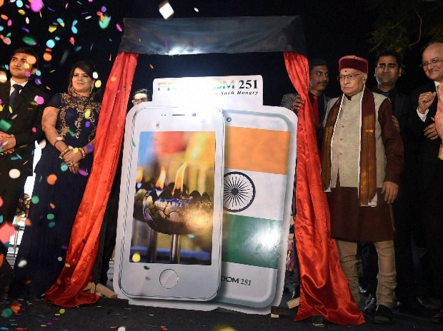 BJP Senior leader Murli Manhor Joshi ,Director of Ringing Bells, Mohit Goel and CEO, Dhaarna Goel during the launch of Smartphone-Ringing Bells Freedom 251, in New Delhi. PTI Photo by Manvender Vashist