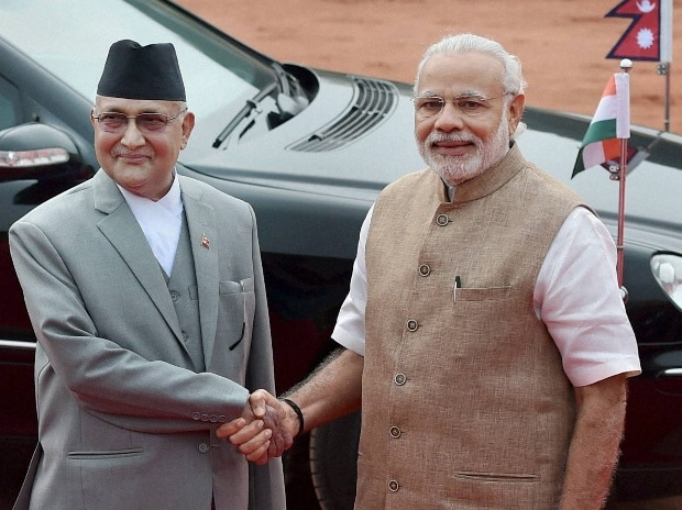 Prime Minister Narendra Modi shakes hands with his Nepalese counterpart Khadga Prasad Sharma Oli  during a ceremonial reception at Rashtrapati Bhavan in New Delhi on Thursday. PTI Photo Vijay Verma