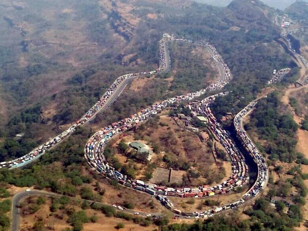 A huge traffic snarl on the ghat road as an oil tanker toppled over on Pune-Mumbai Expressway