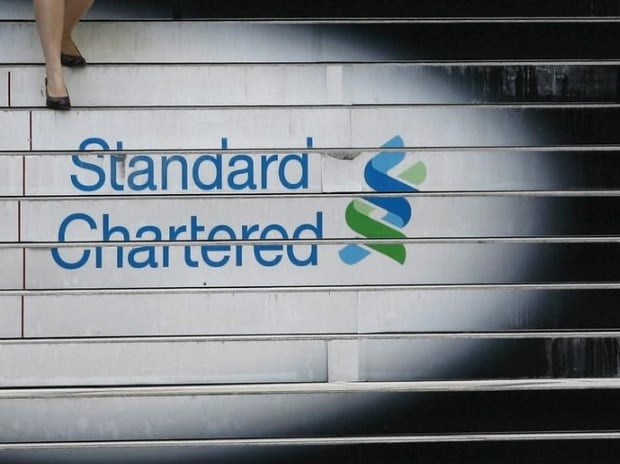 A woman walks down the stairs of the Standard Chartered headquarters in Hong Kong
