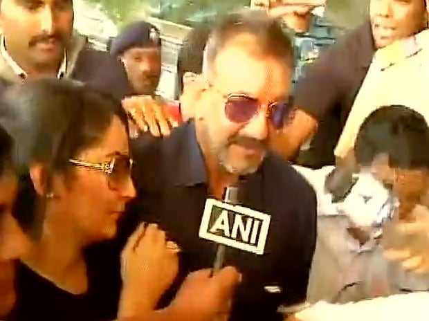 Actor Sanjay Dutt with wife Manyata at Pune Airport after release from Pune's Yerwada Jail. Photo: ANI