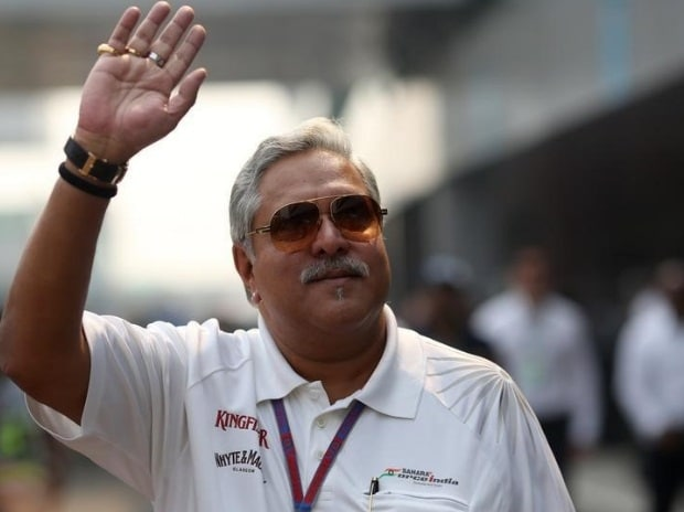 Vijay Mallya waves in the paddock during the third practice session of the Indian F1 Grand Prix at the Buddh International Circuit in Greater Noida, on the outskirts of New Delhi