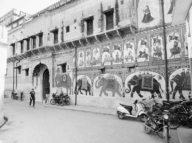 Elephants and tigers form the main frescoes on the facade of the Birla haveli in Pilani