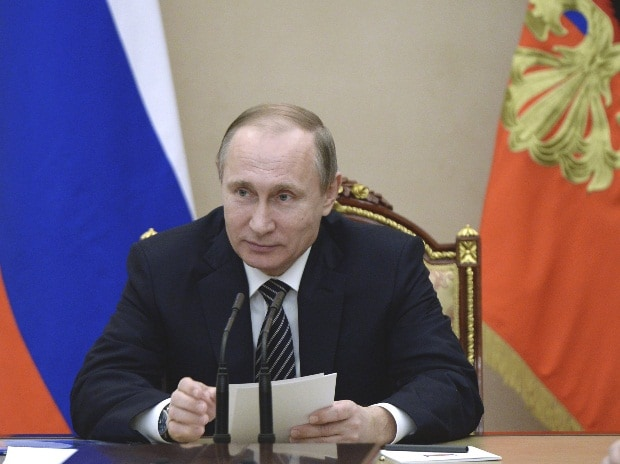 Russian President Vladimir Putin attends a meeting with heads of Russian oil companies at the Kremlin in Moscow