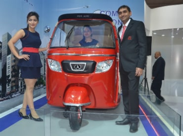 Niraj Chandra, director, Atul Auto Ltd, showcasing the concept model of the smart auto rickshaw at Auto Expo 2016, New Delhi