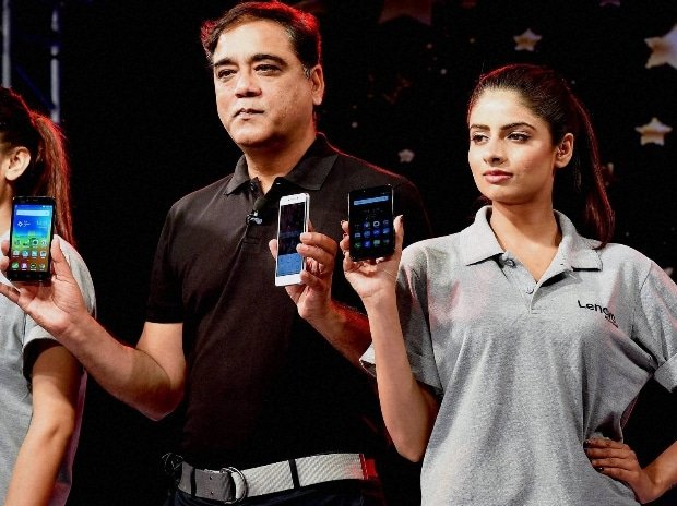 Director-Smartphone Lenovo India, Sudhin Mathur with models at the launch of K5 Plus Smartphones   Photo courtesy: PTI