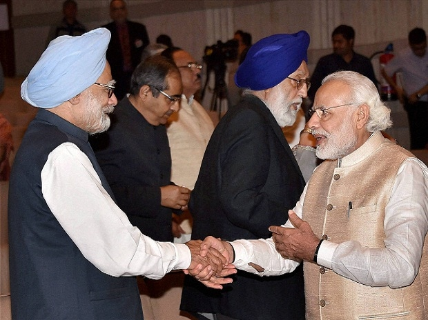 Prime Minister Narendra Modi and former PM Manmohan Singh shake hands at a farewell function for the retired and retiring Members of Rajya Sabha (2016) at Parliament Library Building in New Delhi