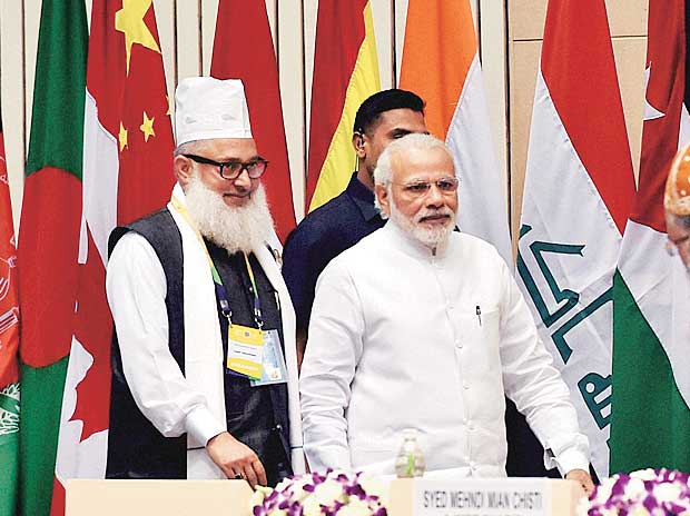 Prime Minister Narendra Modi arrives at the opening ceremony of the World Sufi Forum at Vigyan Bhawan in New Delhi on Thursday