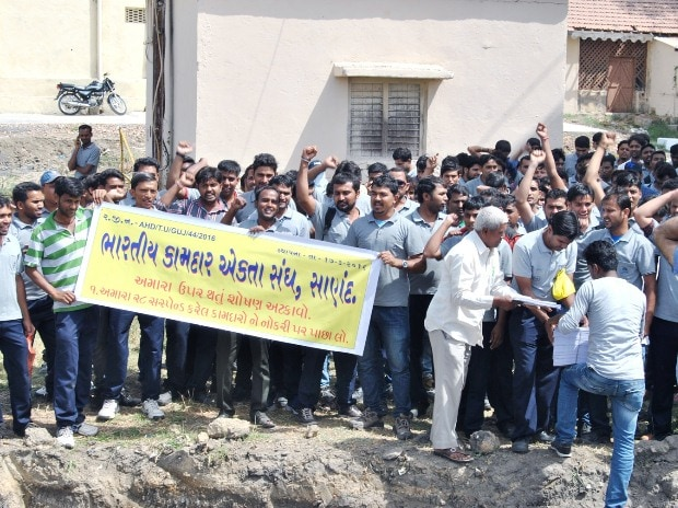 Striking workers at Tata Motors Sanand plant stage a protest at Sanand on Saturday