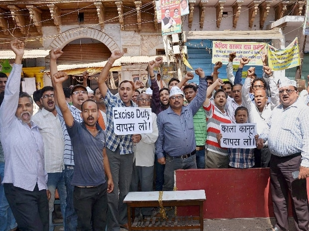 Jewellers block the road during a protest against hike in excise duty on gold in Mirzapur    Photo courtesy: PTI