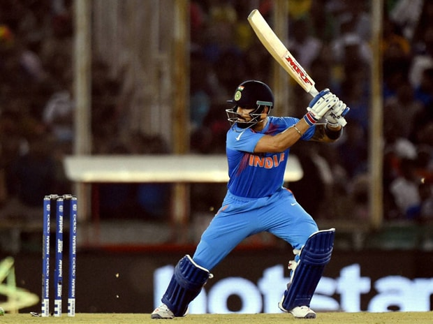 Virat Kohli plays a shot during the ICC World T20 match versus Australia at the PCA Stadium in Mohali. Photo: PTI