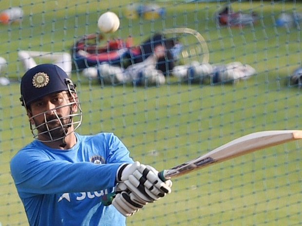 Captain of the Indian cricket team MS Dhoni plays a shot at a practice session ahead of the ICC World T20 semifinal match against the West Indies in Mumbai on Wednesday. Photo: PTI