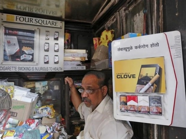File photo of a shopkeeper selling cigarettes waits in his store at a market in Mumbai, India. Photo: Reuters