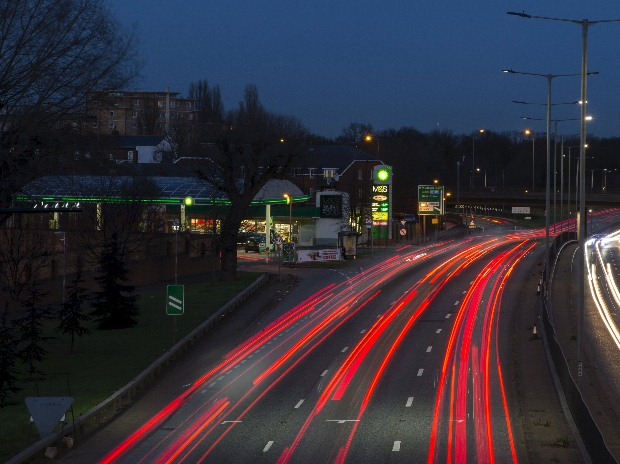 Traffic passes a BP gas station on the North Circular Road in London