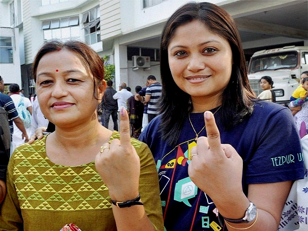 Voters showing their inked finger marks after casting vote in a polling station during the second and final phase of Assam State Assembly election 2016 in Guwahati