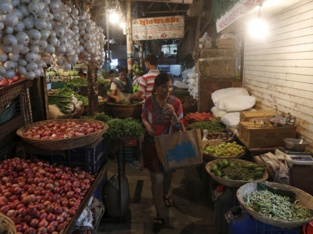 A woman shops at a vegetable market in a residential area in Mumbai