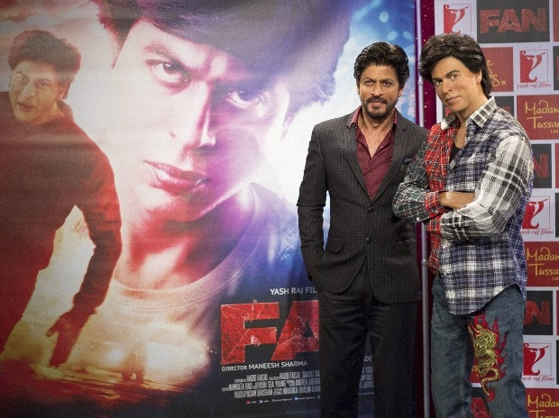 Actor Shah Rukh Khan, left, poses for ...