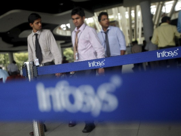 Employees of Indian software company Infosys walk ...