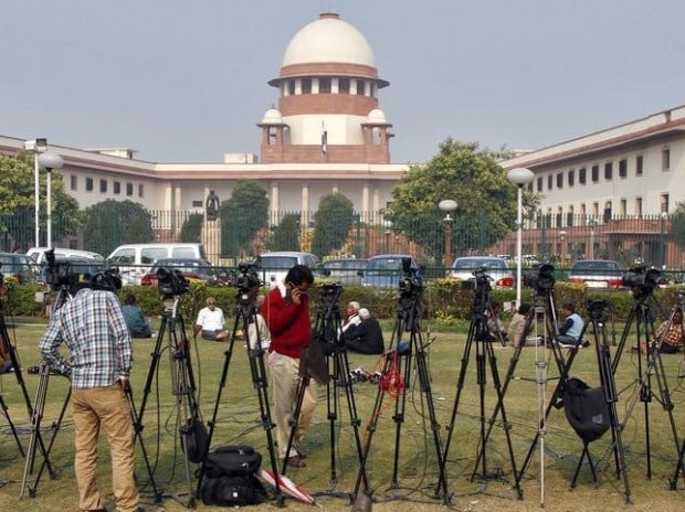 Tripods of television crew stand in front of the Supreme Court building in New Delhi
