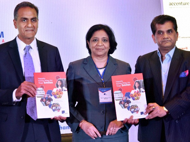 United States Ambassador to India Richard Verma with Chief Executive Officer (CEO) of Niti Aayog Amitabh Kant releases a publication during the 24th Annual Meeting of American Chamber Of Commerce In India, in New Delhi