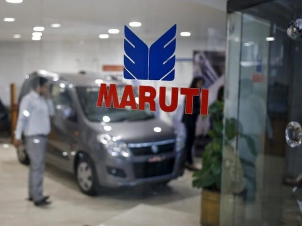 The logo of Maruti Suzuki India Limited is seen on a glass door at a showroom in New Delhi