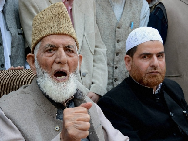 Ailing Chairman of Hurriyat Conference Syed Ali Shah Geelani addressing a press conference at his residence in Srinagar on Monday. PTI Photo