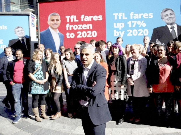 Britain's Labour party candidate for Mayor of London Sadiq Khan watched by Labour Party supporters