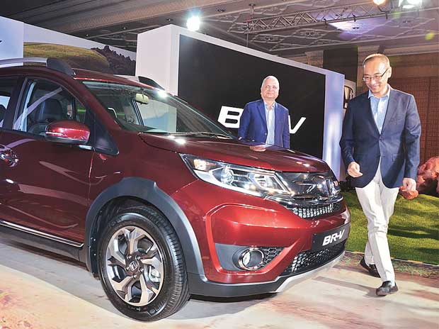 Honda Cars India CEO Yoichiro Ueno (in front) at the launch of the BR-V (diesel) in Mumbai