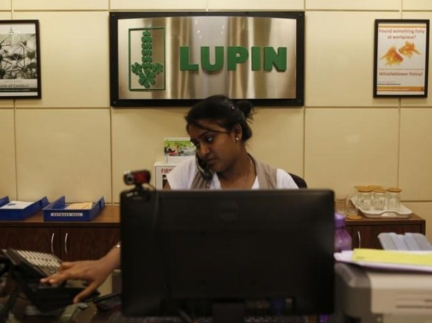 An employee of Lupin Limited works at a reception ...