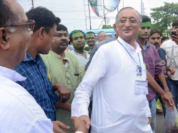 MC candidate Amit Mitra celebrates his victory in West Bengal Assembly eections in North 24 Parganas