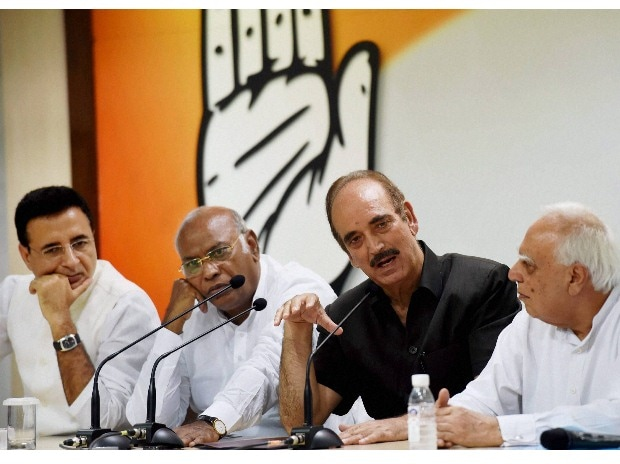 Congress leaders Mallikarjun Kharge, Ghulam Nabi Azad, Kapil Sibal and Randeep Surjewala during a press conference on completion of two years by Modi government, at party headquarters in New Delhi